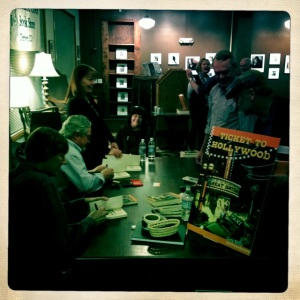 Signing books with Mike Keefe, my partner in Running Meter Press, at Tattered Cover. Photo by Kent Meireis.